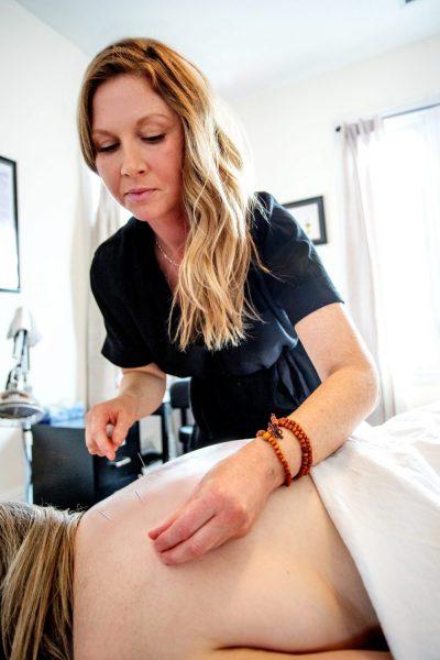 Kerri Stewart, giving acupuncture treatment